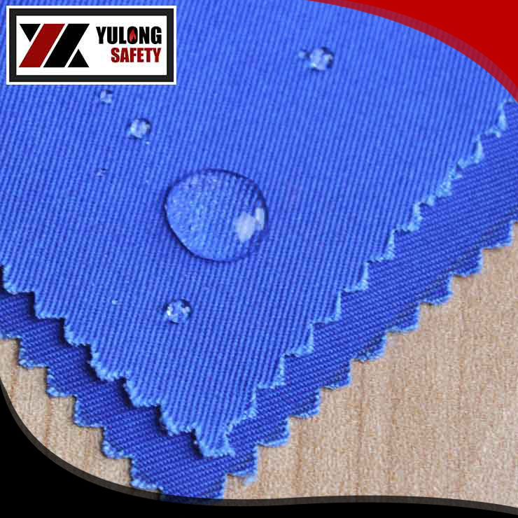 Anti-static flame retardant oil repellent fabric